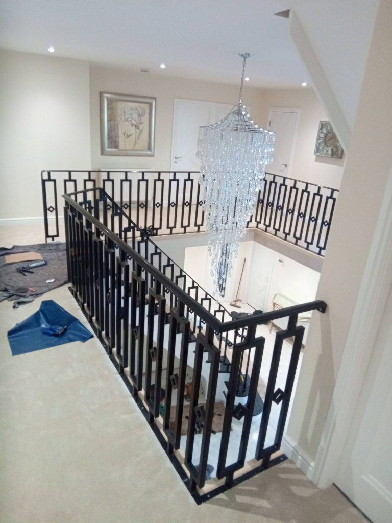 sandbanks poole expensive luxury designer staircase balustrade banister handrails landing gallery galleried black quality staircases by Art Metal Engineering