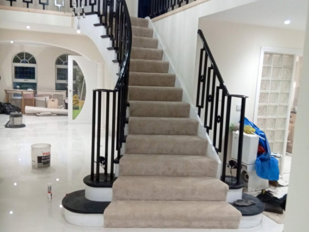grand staircase balustrade designer installation black banister quality staircases by Quality Staircases renovation improvement redesign