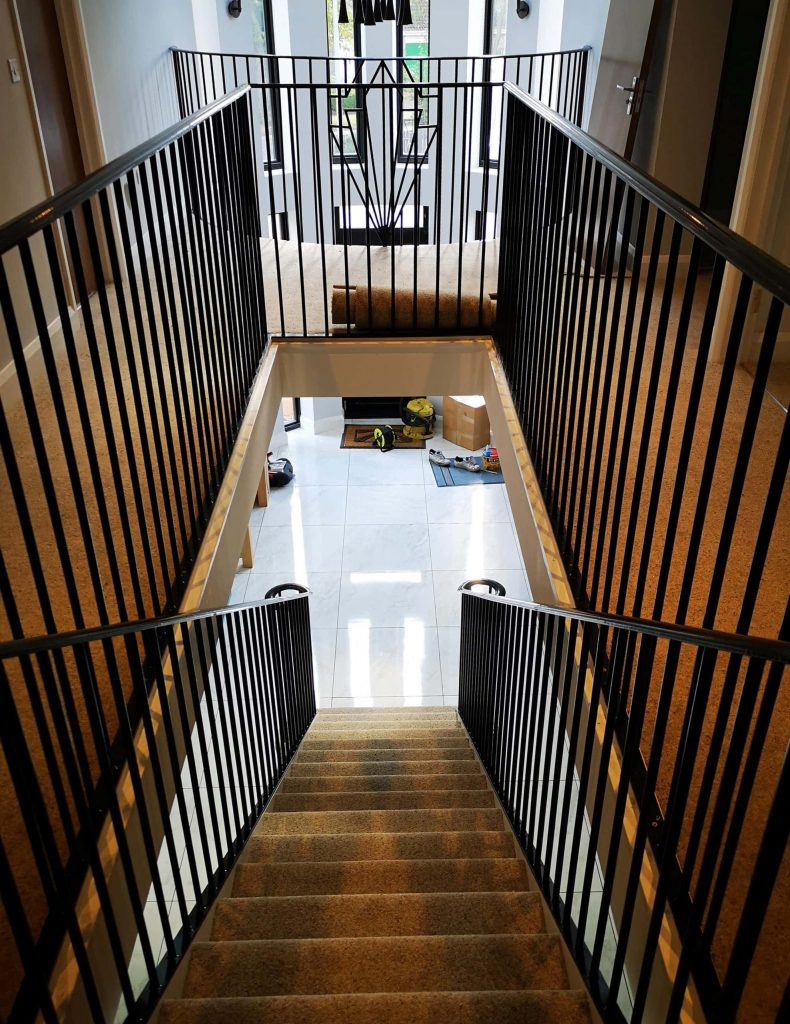 Art Deco themed residential home house luxury designer staircase by Quality Staircases Stamford installation supplier design UK