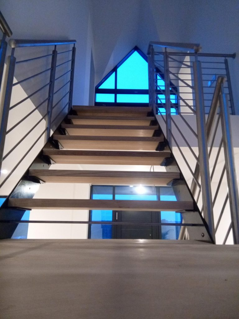Luxury Designer staircase designed and installed in South Lincolnshire Quality Staircases by Art Metal Engineering TV featured in magazines modern