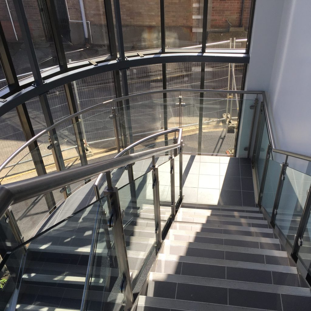 brushed stainless steel curved staircase by Quality Staircases